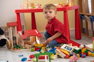 Nursery funding nursery child playing with blocks