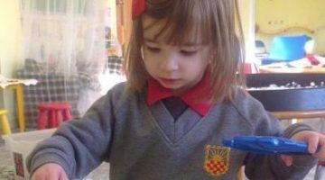 Child playing with mathematics activity